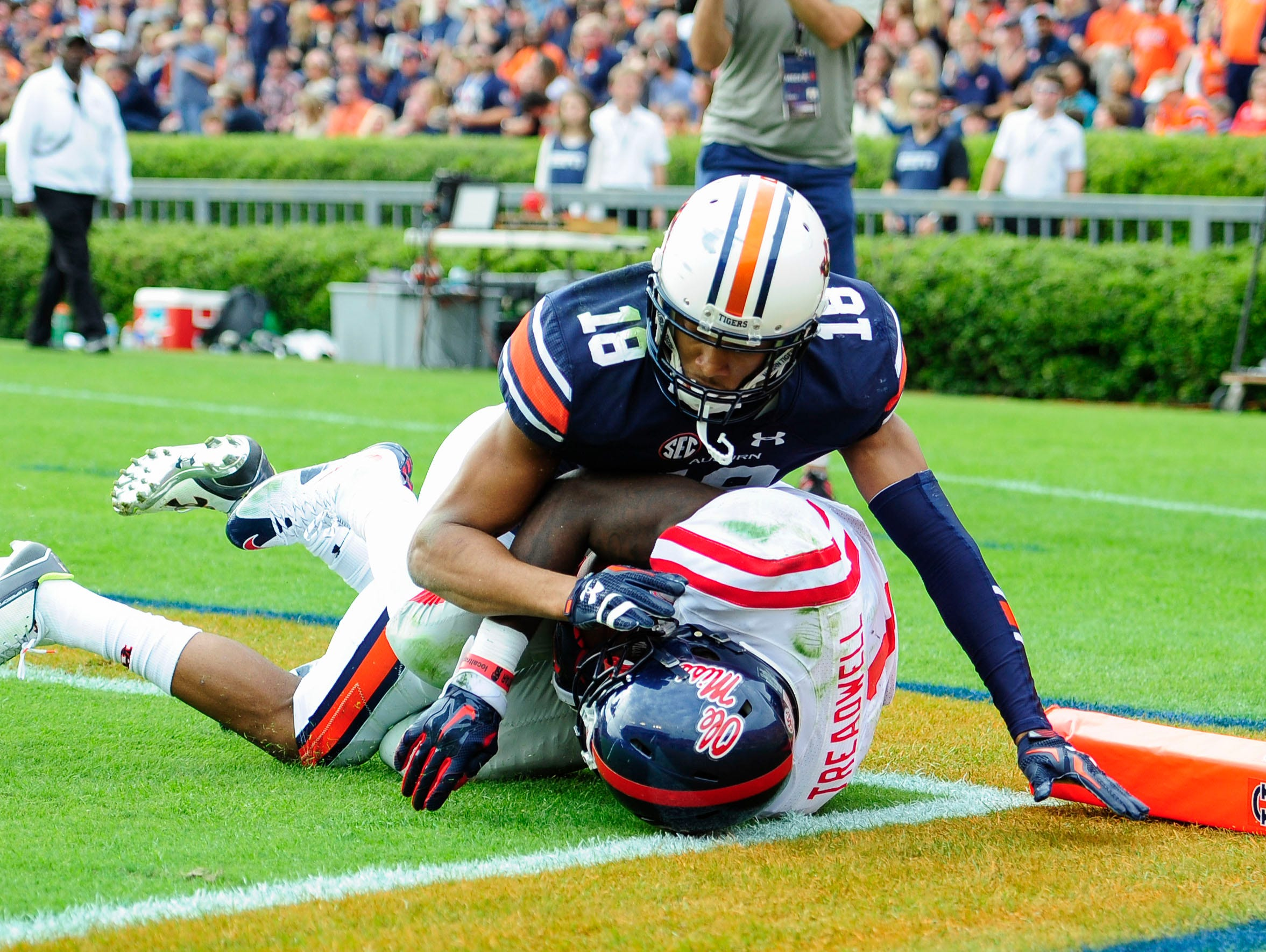Oct 31, 2015; Auburn, AL, USA; Mississippi Rebels wide receiver Laquon Treadwell (1) scores a touchdown as Auburn Tigers defensive back Carlton Davis (18) defends during the fourth quarter at Jordan Hare Stadium. Mississippi won 27-19. Mandatory Credit: Shanna Lockwood-USA TODAY Sports