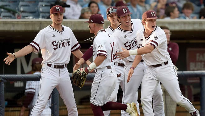The Mississippi State Bulldogs celebrate an inning ending double play against Ole Miss on Tuesday, April 24, 2018, in the Governor's Cup baseball game at Trustmark Park in Pearl, Miss.
