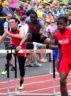 North College Zavontae Chichester clears the hurdle halfway through the Boys 100 Meter Hurdle, May 28.