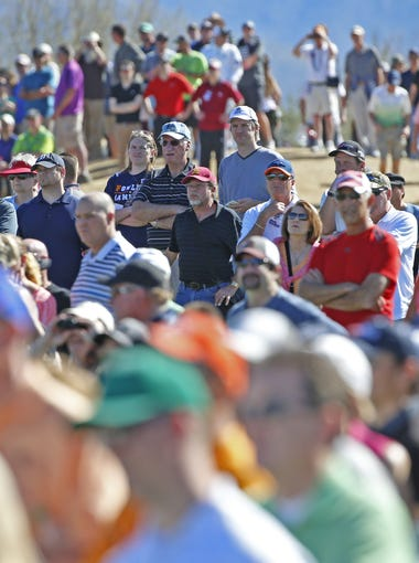 Fans crowd the fairways of the third hole during the fourth round of the Waste Management Phoenix Open golf tournament at TPC Scottsdale in Scottsdale, Az., on Sunday, February 7, 2016.