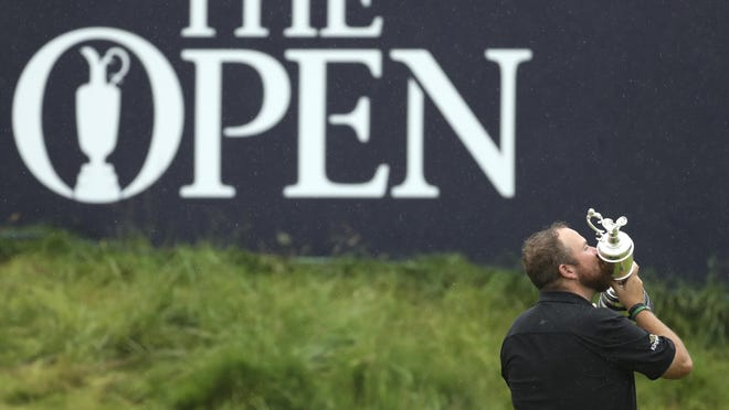 Ireland's Shane Lowry holds and kisses the Claret Jug trophy on the 18th green as he poses for the crowd and media after winning the British Open Golf Championships at Royal Portrush in Northern Ireland. The organizers of the British Open announced Monday April 6, 2020, that they have decided to cancel the event in 2020 due to the current Covid-19 pandemic and that the Championship will next be played at Royal St George's in 2021.