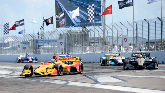 Ryan Hunter-Reay (28) and James Hinchcliffe (5) come into Turn 1 at the start of the IndyCar Firestone Grand Prix of St. Petersburg, Sunday, March 11, 2018, in St. Petersburg, Fla.