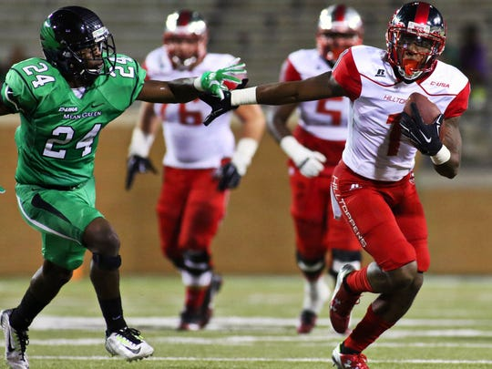 Oct 15, 2015; Denton, TX, USA; Western Kentucky Hilltoppers wide receiver Nacarius Fant (1) runs after the catch as he holds off North Texas Mean Green defensive back Zac Whitfield (24) during the second half of game at Apogee Stadium. Western Kentucky won 55-28. Mandatory Credit: Ray Carlin-USA TODAY Sports