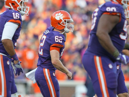 Clemson long snapper David Estes runs off the field with teammates after kicker Greg Huegel (92) makes a field goal during the third quarter on Saturday at Memorial Stadium in Clemson.