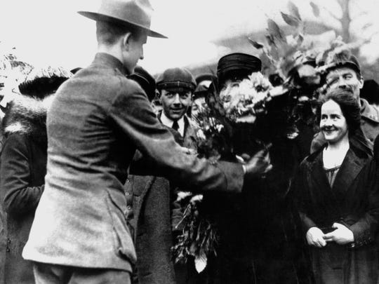 Grateful French women present flowers to wounded Marines in France following battle of Belleau Wood in 1918.
