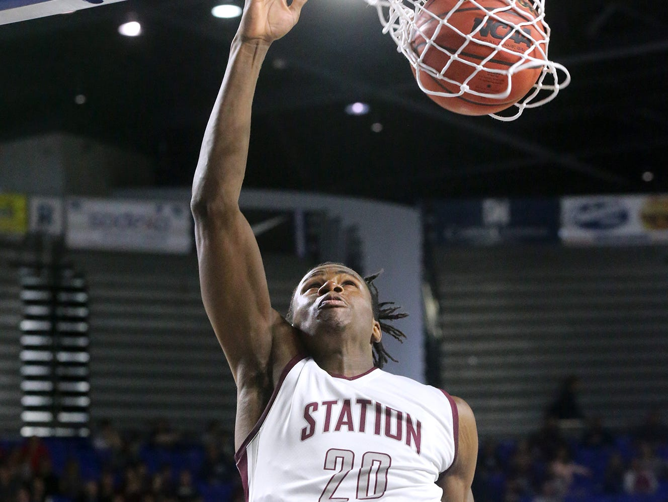 Station Camp's Yalen Reed (20) goes up for a shot against David Crockett during the Class AAA boys quarterfinals at MTSU's Murphy Center Wednesday.