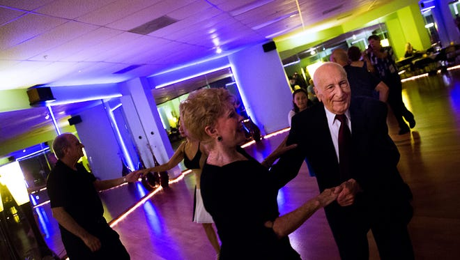 Harry Tahan, 96, dances the hustle with Marlene Simmons on Friday, April 7, 2017, at the DanceLife of Southwest Florida Ballroom Studio in Bonita Springs. Tahan has been coming to this studio for seven years out of the roughly 50 years he has been dancing.