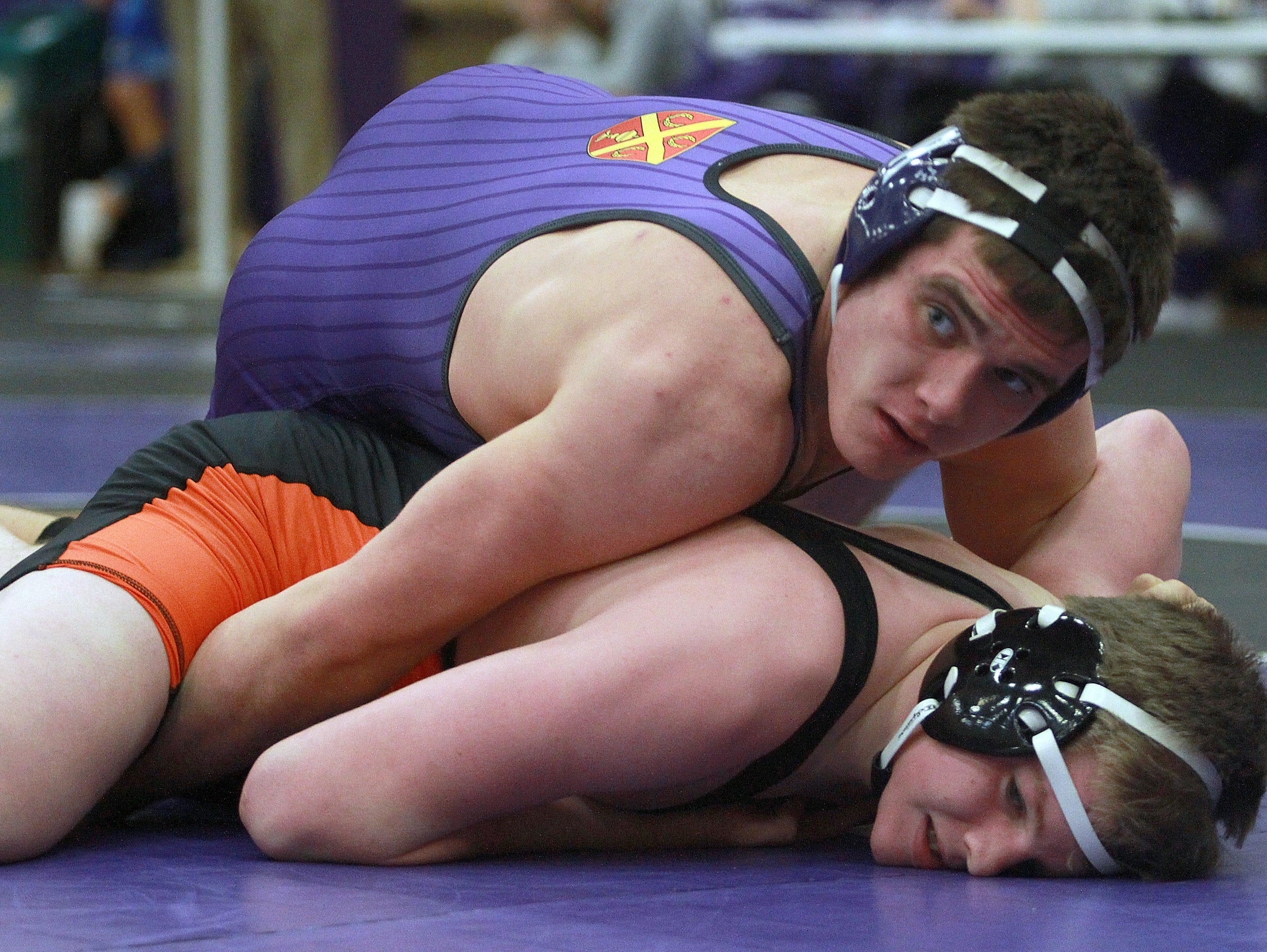 Ben Stacey (top) and his Father Ryan teammates will be vying for a Division II state title at the TSSAA State Duals Friday and Saturday.