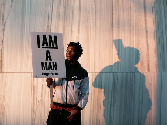 "February 12, 2018 -  Tyree Grimes, 20, of St. Louis, Missouri, holds a ""I Am a Man"" sign outside of Memphis City Hall following the Honoring Sanitation Strike March from Clayborn Temple on Monday. The event, which commemorates the fiftieth anniversary of the 1968 Sanitation Strike, was hosted by Fight for $15 and the Poor People's Campaign."