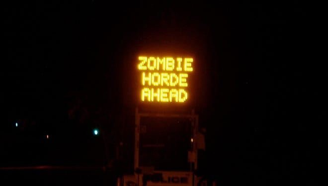 """An Englewood Cliffs police message board flashed the words, """"Run for your liff [sic], zombie horde ahead"""" on Charlotte Place in 2010."""