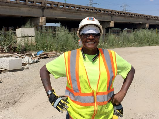 Shandra Dunn, 44, of Detroit stands next to I-75 south
