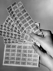 Various trading stamps are seen in this 1965 photo.