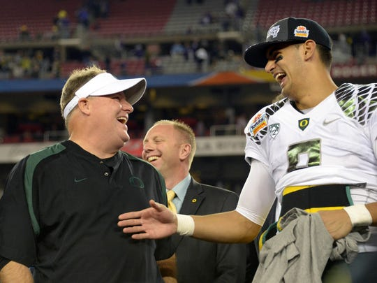 Then-Oregon coach Chip Kelly and  quarterback Marcus