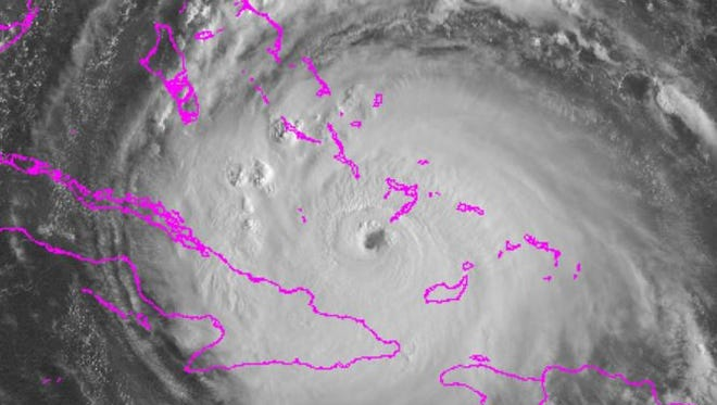 A Friday morning satellite image shows Hurricane Irma passing north of Cuba as it approaches Florida.