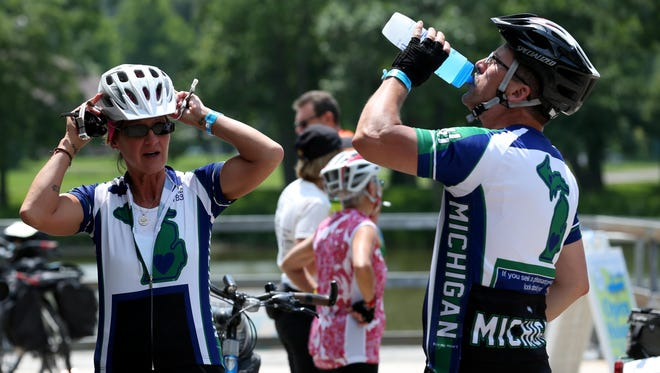 Donna Tolan and her husband, Kendall, of Middleville, Michigan, take a pit stop in Rochester during their ride along the historic Erie Canalway Trail from Buffalo to Albany on Monday, the second day of the 17th annual 400-mile Cycle the Erie Canal tour.