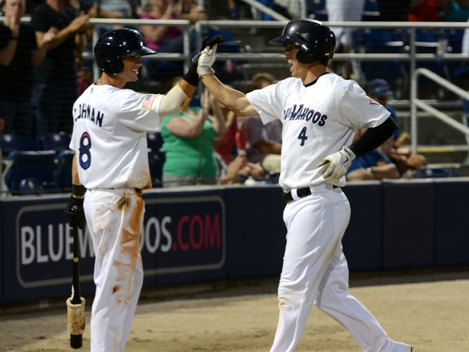 Pensacola Blue Wahoos' Brodie Greene is congratulated by teammate Devin Lohman after hitting a home run Monday in a game against the Jacksonville Suns at Blue Wahoos stadium.