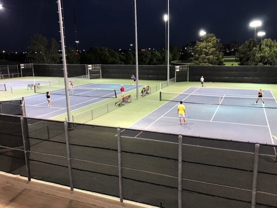 The two Wylie mixed doubles teams play under the lights of the McLeod Tennis Center at Texas Tech in Lubbock during the Region I-4A tennis championships on Tuesday night.