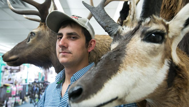 Archery Hunt, Borderland Taxidermy owner Jacob Ellis is pictured in his store located at 1400 E. Idaho Ave. with his taxidermy examples on Thursday.