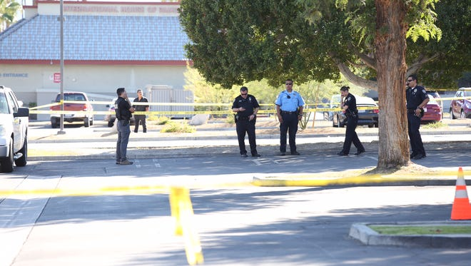 Palm Springs police investigate an officer-involved shooting in a parking lot between Palm Canyon and Indian Canyon drives near Ramon Road on Friday, Nov. 4, 2016.
