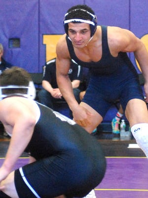 Rutherford senior Omar Abdelhamid looking to make a move against Bogota/Weehawken's Alfonso Salandra on Saturday.
