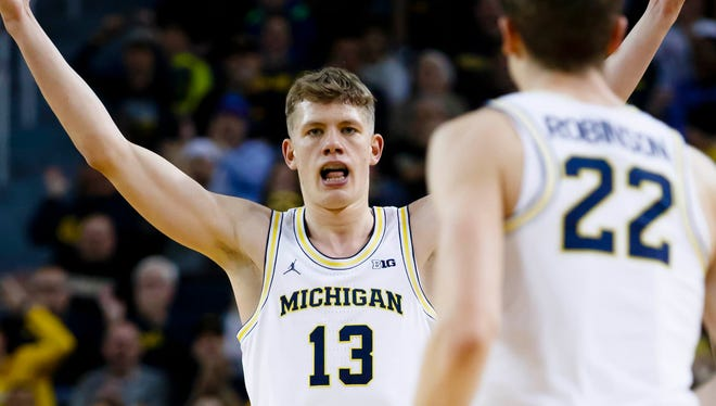 Michigan forward Moritz Wagner (13) celebrates after he makes a three-point basket in the first half Saturday in Crisler Center.