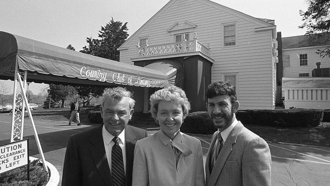Country Club president Rex Sessions, his wife, Betsy, and general manager Dwight Eastman in 1983.