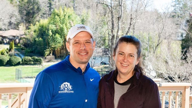 Hendersonville Racquet Club owners Chris, left, and his wife, Cindy.