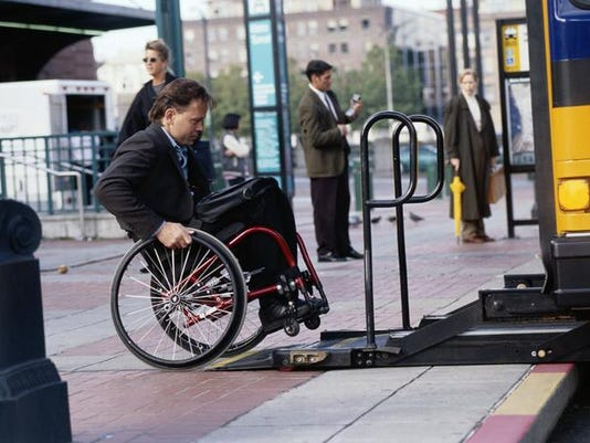 Man in Wheelchair Entering Bus