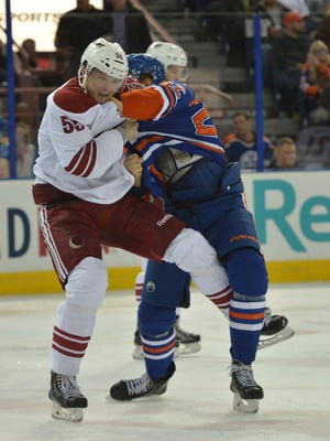 Oct 1, 2014: Edmonton Oilers defenseman Keith Aulie (22) fights against  Arizona Coyotes defenseman Matt Smaby (55) in the second period at Rexall Place.