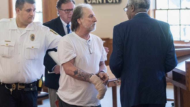 Stephen Zawodna, center, leaves the courtroom after a hearing on Friday.