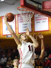 Marist College's Tobias Sjoberg goes for a layup during