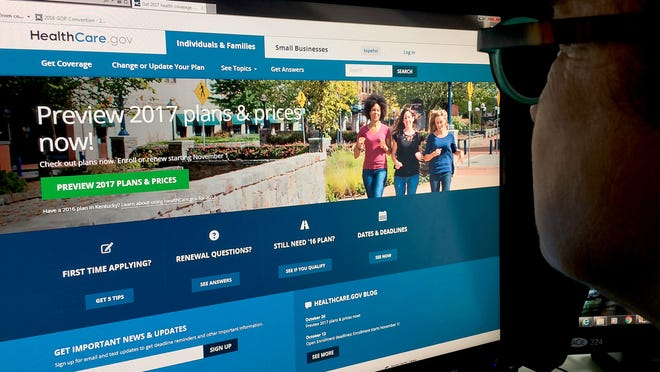 A woman looks over at the Healthcare.gov site. The sixth open-enrollment period ends Dec. 15.