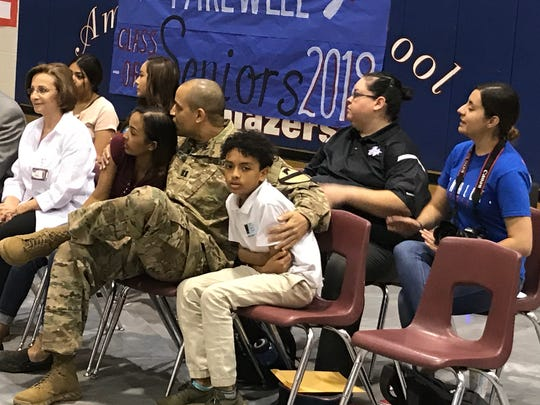 U.S. Capt. Michael Collins surprised his young children by returning from Iraq to see one of his daughters graduate.