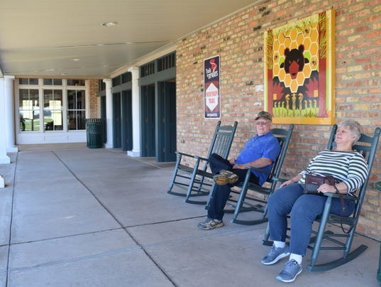 J.D. and Joyce Mills of Houma relax outside the state of Louisiana Welcome Center located along I-49 near Boyce. The Mills regularly stop by the center to relax as they travel.
