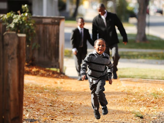 Patrick Genda, 4, runs ahead of his father Joseph and brother Norman, 10, near their home in Salt Lake City on Sunday, Nov. 18, 2018.