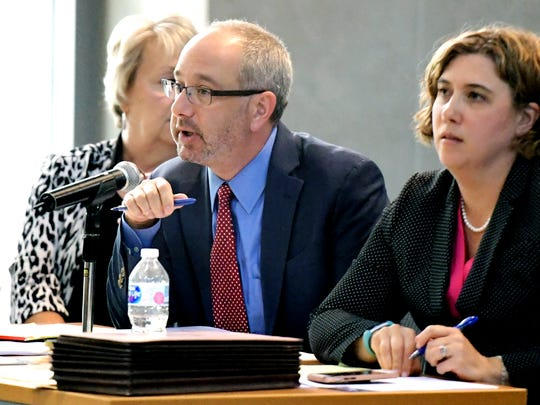 Citizens to Stop Transource attorneys Jordan Yeager and Joanna Waldron address administrative law judges during a prehearing conference Monday, July 9, 2018, at the Commonwealth Keystone Building in the Pennsylvania State Capitol Complex in Harrisburg. Transource Energy is asking the state to consolidate its two applications into one case in order to receive approval to construct new overhead power lines in Franklin and York counties. Bill Kalina photo