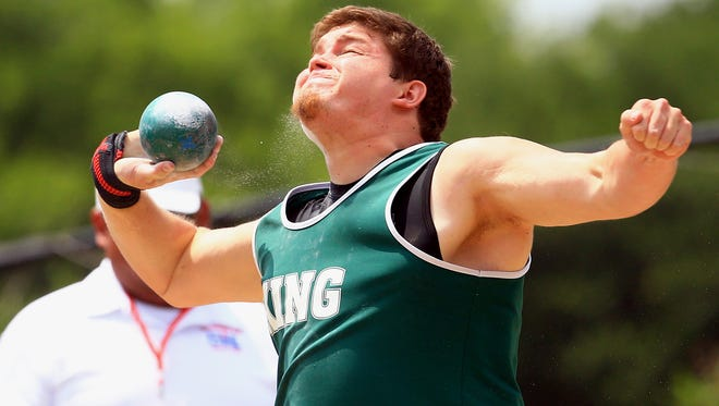 King's Robert Gonzalez throws the shot put as he competes in the boys shot put during the Region IV-5A Track and Field meet at Alamo Stadium in San Antonio.