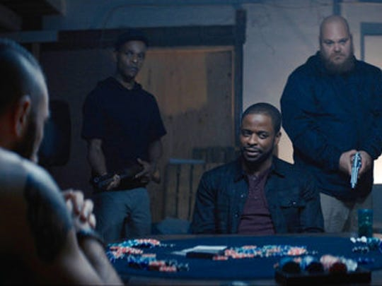 "This image released by WWE Studios shows Dule Hill, seated center, in a scene from, ""Sleight."""