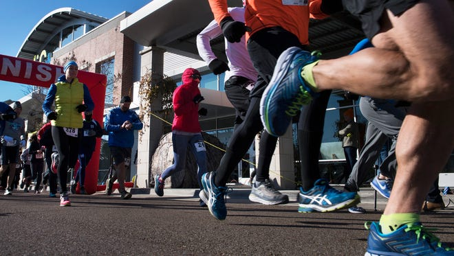Runners take off at the start of LIFT Wellness Center's fourth annual Commitment Day 5K race on Monday, Jan. 1, 2018, in Jackson. All proceeds benefited Regional Inter-Faith Association of Jackson.
