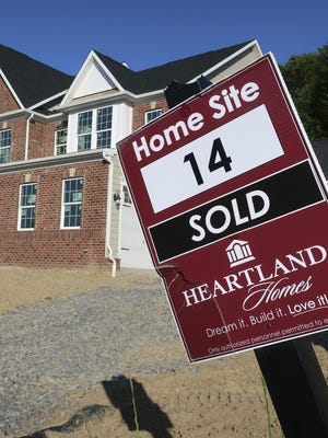 A sold sign stands in front of a home under construction in Hampton Township, Pa.