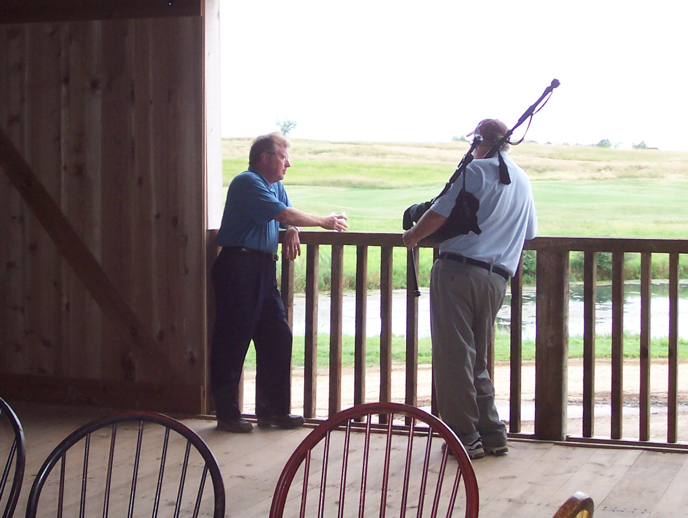 Erin Hills owner Bob Lang chats with a guest overlooking