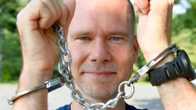 Marc Griffin of Stuarts Draft wears the handcuffs that helped him earn his way into the Guiness Book of World Records. He broke the record for fastest time running a marathon wearing handcuffs when he ran the Potomac River Run in Washington, D.C., back in May.