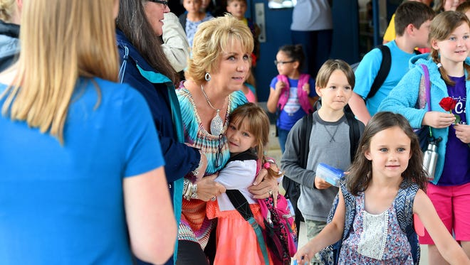 First grade teacher Mary Flint receives a hug from a student as teachers say a final goodbye to the children who head to the buses outside. Beverley Manor Elementary marked its final day as the school year came to a close on Monday, May 23, 2017.