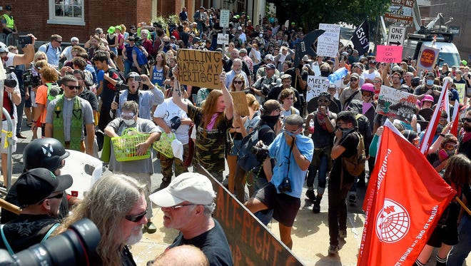 Counter protesters fill the street as they stand in opposition to white nationalists gathered. Saturday's planned rally at Emancipation Park started early with fighting and devolved into bottle-throwing clashes between racist alt-right demonstrators who organized the event, white nationalists, neo-Nazis and counter protesters in Charlottesville. Later during a counter march along Water Street near the Mall, a driver drove his car into a group of protesters, killing one.