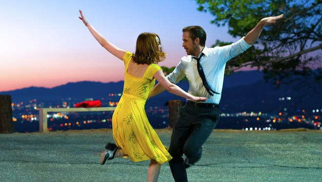 """This image released by Lionsgate shows Ryan Gosling, right, and Emma Stone in a scene from, """"La La Land."""" The film was nominated for a Golden Globe award for best motion picture musical or comedy on Monday, Dec. 12, 2016. The 74th Golden Globe Awards ceremony will be broadcast on Jan. 8, on NBC. (Dale Robinette/Lionsgate via AP)"""