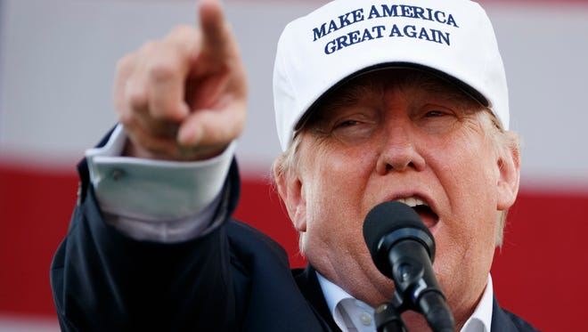 Donald Trump's election makes many voters feel better, not worse, a Mason resident writes. Shown, the Republican presidential candidate speaks during a campaign rally in Miami shortly before the election.