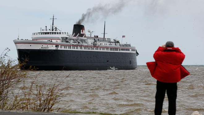 A man takes a picture from the shore as the S.S. Badger arrives in Manitowoc after its first voyage of the season Friday, May. 19, 2017, in Manitowoc, Wis. Josh Clark/USA TODAY NETWORK-Wisconsin