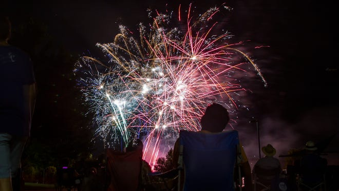 Fireworks explode during 4th Fest in Coralville on Wednesday, July 4, 2018.
