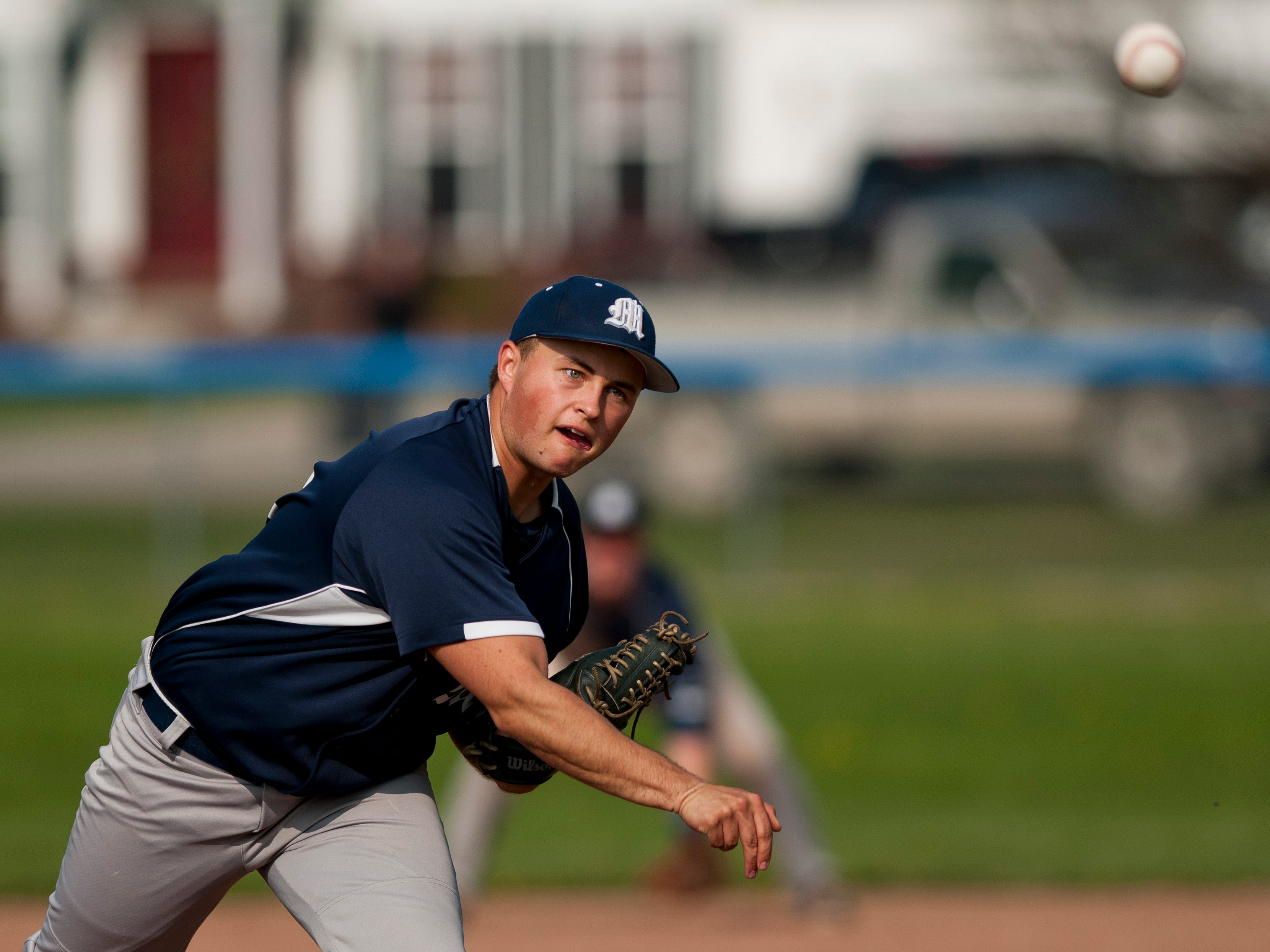 Marysville's Jacob Drewek throws a pitch during a baseball game Wednesday, May 6, 2015 at St. Clair High School.