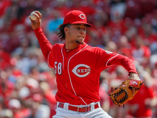 Cincinnati Reds starting pitcher Luis Castillo throws in the first inning of a baseball game against the St. Louis Cardinals, Saturday, June 9, 2018, in Cincinnati. (AP Photo/John Minchillo)